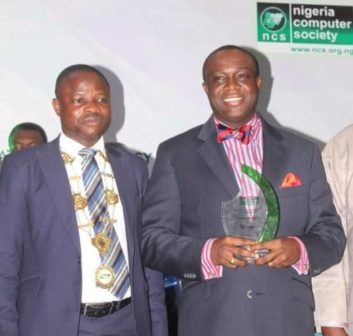 President of NCS, Prof. Sola Aderounmu and IT Man of the Year, Yele Okeremi